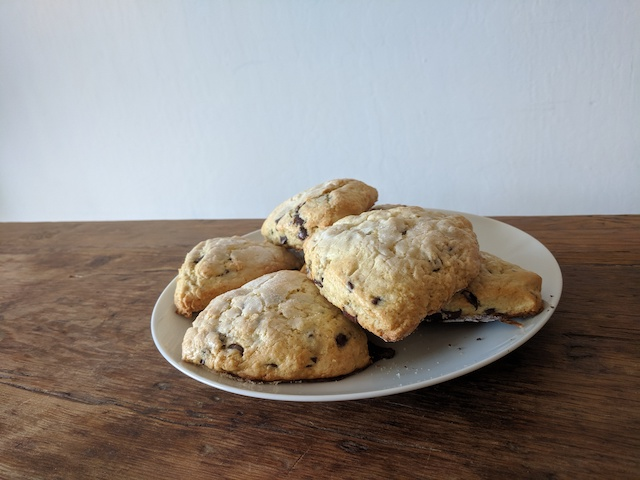 A plate full of chocolate chip scones